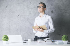 Attractive guy with notepad Royalty Free Stock Photos