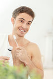 Attractive guy is preparing himself for a date Royalty Free Stock Image