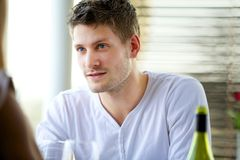 Attractive Guy Seriously Listening. Portrait of an attractive guy seriously listening to someone Royalty Free Stock Photos