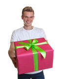 Attractive guy showing his christmas gift Stock Image