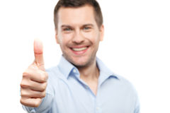 Attractive guy is showing ok sign Royalty Free Stock Image