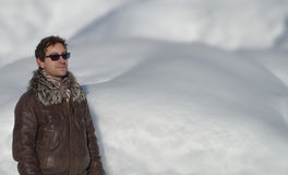 Attractive guy and snow. Large copyspace. Good looking young man in front of snow. Copyspace, large space for text Royalty Free Stock Photo