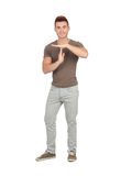 Attractive guy with spiky hair gesturing time-out Royalty Free Stock Photography