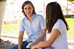 Attractive guy talking to a girl Royalty Free Stock Photo