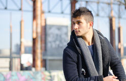 Attractive guy in urban environment, large copy-space Royalty Free Stock Image