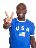 Attractive guy from USA showing victory sign Stock Photos