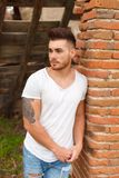 Attractive guy with white t-shirt Royalty Free Stock Photos