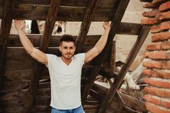 Attractive guy with white t-shirt in a old house. Image for ad Stock Photo