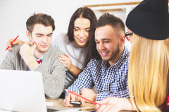 Attractive guys and girls working together Stock Photos