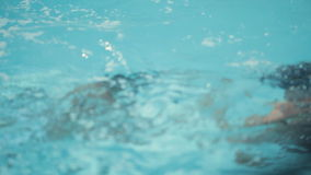 Attractive guys in the pool splashing, dive and stock footage