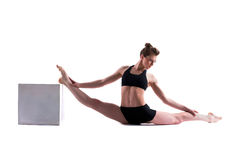 Attractive gymnast posing with cube in studio Royalty Free Stock Photo
