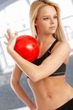 Attractive gymnast practicing with ball Stock Photo