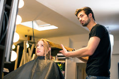 Attractive hair dresser Stock Photos