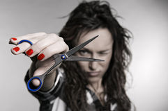 Attractive hairdresser with scissors Stock Image