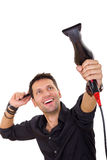 Attractive hairdresser using blow dryer and comb Royalty Free Stock Photography