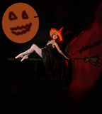 Attractive Halloween witch on broom Royalty Free Stock Images