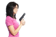 Attractive hand gun woman. Attractive hispanic woman holding a hand gun on a white background Stock Photo