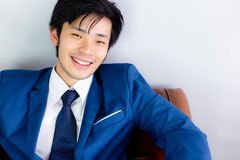 Attractive handsome businessman gets happiness with smile face. stock photo