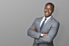 Attractive handsome happy smiling professional businessman executive with a stylish suit and tie. Strong powerful handsome african american modern businessman Royalty Free Stock Photo