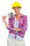 Attractive handy woman holding a brush and smiling at camera. On white background Stock Image