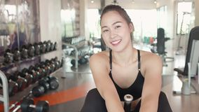 Attractive happiness sport woman resting and relaxing on fitness gym bench and smiling. People lifestyle and healthy activity and. Leisure concept. Happy stock video footage