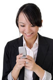 Attractive happy business woman reading SMS Royalty Free Stock Photo