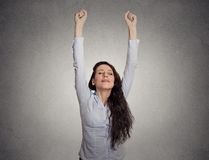 Attractive happy businesswoman with her arms raised royalty free stock photo