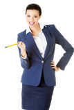 Attractive happy businesswoman with pen Stock Photography
