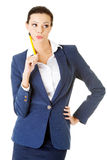 Attractive happy businesswoman with pen Stock Image