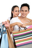 Attractive happy couple carrying shopping bag Stock Photo