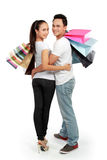 Attractive happy couple carrying shopping bag. Full lenght portrait of happy couple carrying shopping bag on white background Royalty Free Stock Photography