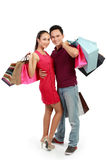 Attractive happy couple carrying shopping bag Stock Photography