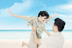 Attractive happy couple have fun on beach Stock Image