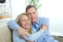 Happy couple in love hug each other on bed at home Stock Photos