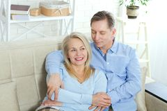 Happy couple in love hug each other on bed at home Stock Image