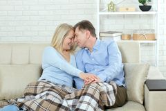 Happy couple in love hug each other on bed at home Royalty Free Stock Photography