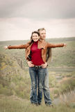 Attractive happy couple posing in the wilderness Royalty Free Stock Image