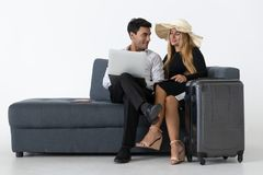 Attractive happy couple sitting and planning vacations trip. Summer vacation concept.  stock photos