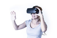 Attractive happy and excited woman using 3d goggles watching 360 virtual reality vision Royalty Free Stock Photos