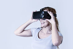 Attractive happy and excited woman using 3d goggles watching 360 virtual reality vision Stock Image