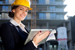 Attractive happy female construction specialist Stock Photography