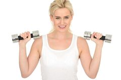 Attractive Happy Fit Healthy Young Blonde Woman Working Out with Dumb Bell Weights Royalty Free Stock Photography