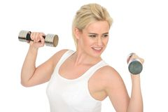 Attractive Happy Fit Healthy Young Woman Working Out with Dumb Bell Weights Royalty Free Stock Images
