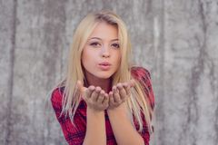 Attractive happy girl with blonde hair, big lips, with perfect s stock photos