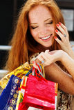 Attractive happy girl out shopping. Attractive happy teenager girl with colorful shopping bags Stock Photo