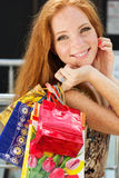 Attractive happy girl out shopping. Attractive happy teenager girl with colorful shopping bags Royalty Free Stock Photo