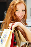 Attractive happy girl out shopping Stock Photos