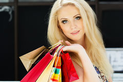 Attractive happy girl out shopping. Attractive happy teenager girl with many colorful shopping bags Royalty Free Stock Photos