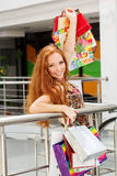 Attractive happy girl out shopping. Attractive happy teenager girl with many colorful shopping bags Royalty Free Stock Photography