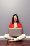 Happy girl using laptop and smiling Stock Photo
